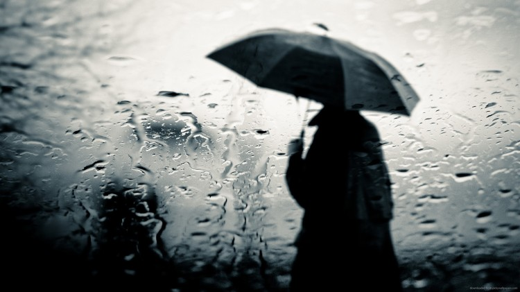 man-in-the-black-cloak-under-the-rain