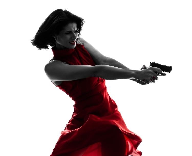 one sexy caucasian woman holding gun in silhouette studio isolat